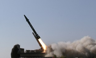 Iranian ballisitic missile launched at war game. Photo: Ho New / Reuters