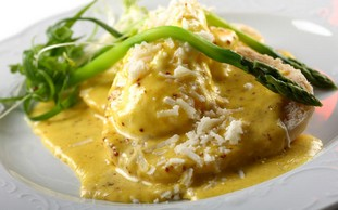 Eggs Benedict with asparagus and parmesan cheese
