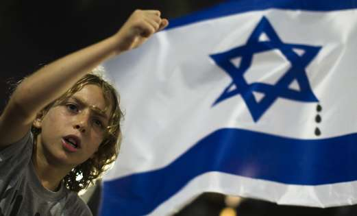A boy at the Tel Aviv rally against housing prices