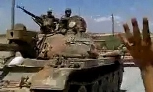Syrian soldiers man tank (illustrative)