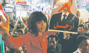 Girl holds poster of Assad