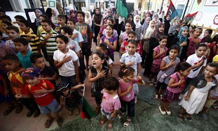 Libyan children sing new national anthem.