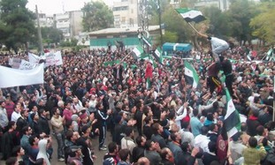 Syrian demonstrators protest against Assad in Homs