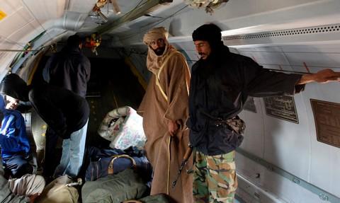 Saif al-Islam Gaddafi is seen standing in a plane