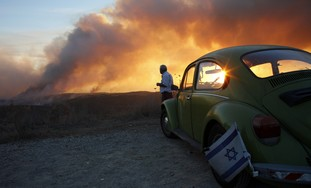 Man surveys Carmel fire at Kibbutz Beit Oren