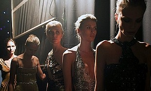 Models are seen at backstage