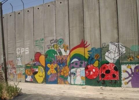 Banksy art on the West Bank security barrier (Photo by: Elisa L. Moed, Travelujah)
