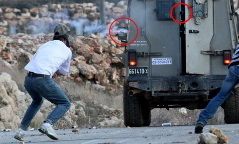 Tamimi (left) a moment before his injury; Emphasis on barrels added by Popular Struggle Coordination Committee.