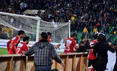 Soccer players flee as chaos erupts in Egypt