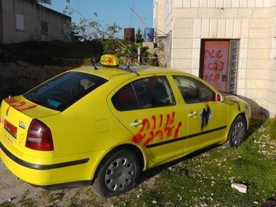 Graffiti on Al-Jeniya taxi cab (Ayyad Madloum)