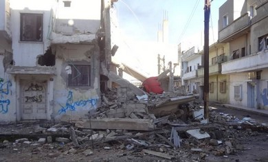 Bab Amro neighborhood of Homs following shelling