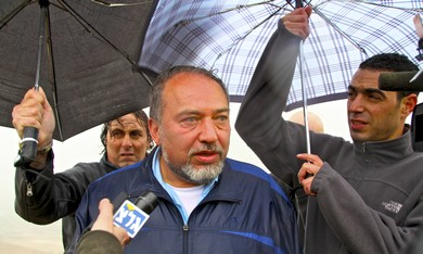 FM Liberman in the rain near Jordan Valley