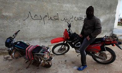 Free Syrian Army member on a motorcycle [file]