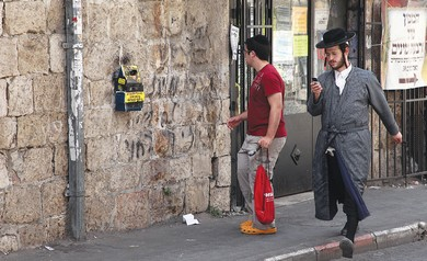 Haredi and secular in Mea Shearim