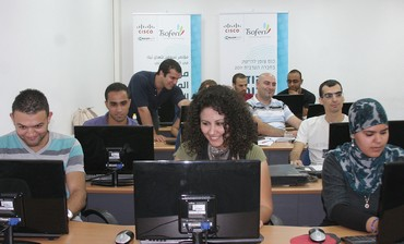 Israelis working at computer desks