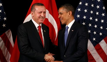 US President Obama shakes hands with Turkeys PM