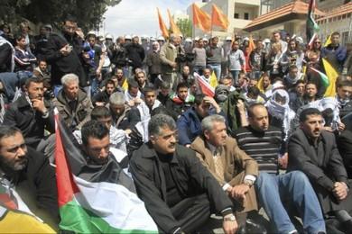 Palestinian protesters sit in road near Bethlehem (Tovah Lazaroff)