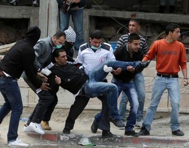 A wounded Palestinian protester at Kalandiya is evacuated (Reuters)