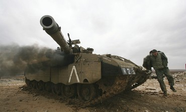 IDF soldier, tank outside northern Gaza