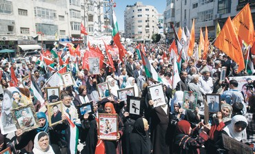 PALESTINIANS RALLY in Ramallah for Prisoners Day - Photo: Mohamad Torokman/Reuters