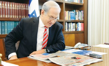 PM Netanyahu reading 'The Jerusalem Post' [file]