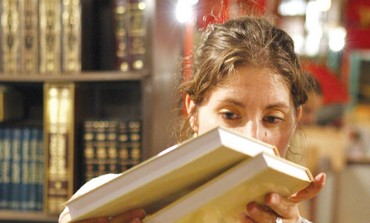 A woman searches through books