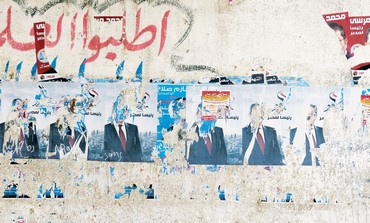 Ripped posters of Amr Moussa in Cairo