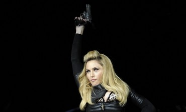 Madonna with gun in MDNA tour