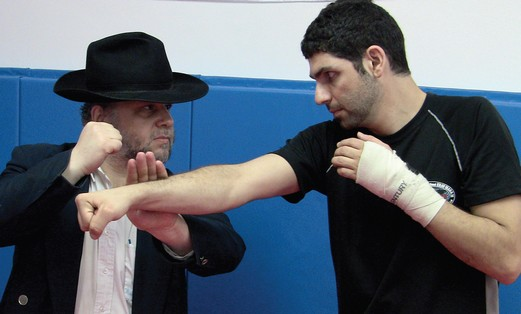 AVI SCHWARTZ with one of his students