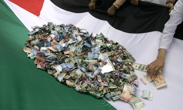 Palestinians collect money [illustrative]