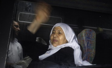 Palestinian woman leaving Gaza to visit relative