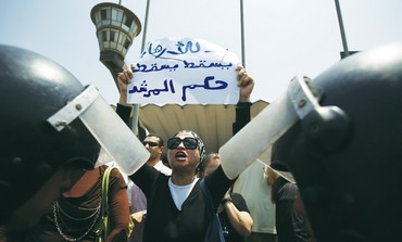A woman shouts slogans against Egypt's President M