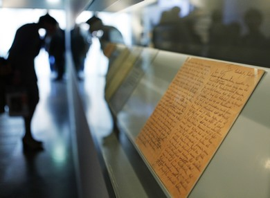 A visitor looks at the pages of Anne Frank