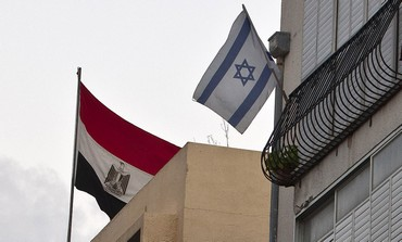 Egyptian flag hangs at embassy in Tel Aviv