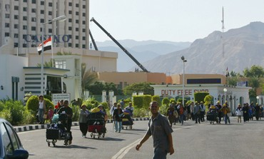 Tourists cross the Egypt-Israel Taba border