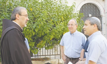 Ron Kronish (center) and Gadi Gvaryahu meet.