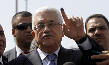 President Abbas shows ink-stained finger