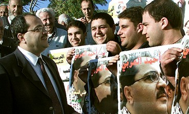 Hadash activists greet Ahmed Tibi