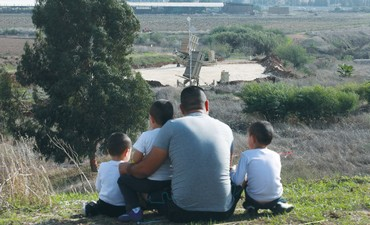 Onlookers at Gush Dan Iron Dome battery