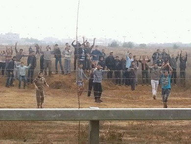 Dozens of Gazans hurl rocks on Gaza side of border fence (IDF Spokesman)
