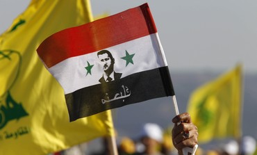 Flags of Hezbollah, Assad's Syria - Photo: REUTERS/Ali Hashisho