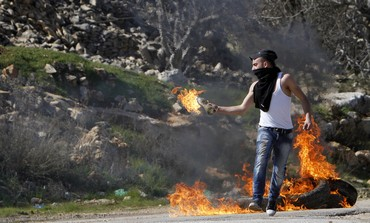 Palestinian throwing a molotov cocktail [file].