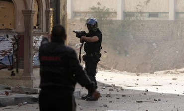 Protester tries to stop Egyptian policeman, January 25, 2013