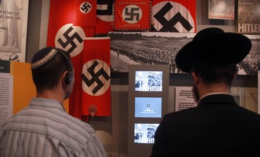 Jewish men looking at Holocaust exhibit in Yad Vashem, January 27, 2013.