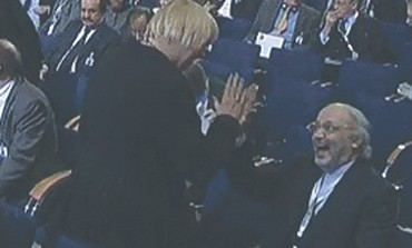 CLAUDIA ROTH, head of Germany's Green Party, high-fives Iranian Ambassador Ali Reza Sheikh Attar