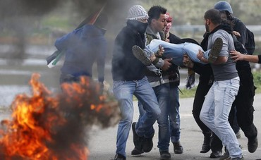 Several Palestinians, 3 journalists hurt in Ofer riots