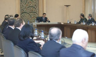 Syria's President Bashar Assad (center L) heads a cabinet meeting in Damascus, Feb. 12
