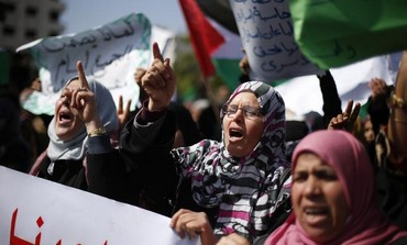 Protest against the death of a Palestinian detainee in an Israeli jail, in Gaza February 24, 2013