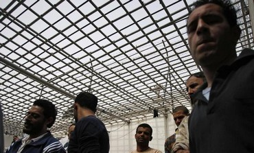 Palestinian inmates stand together in a prison in the West Bank town of Jericho