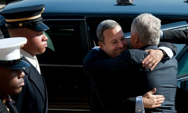 Defense Minister Barak embraces US counterpart Hagel , March 5, 2013
